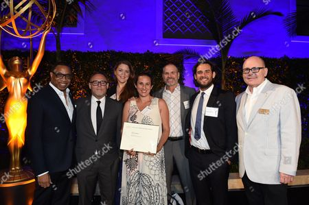 Stock Picture of Tim Gibbons, Hayma Washington, Bryan Burk, Athena Wickham, Richard J. Lewis, Roberto Patino and Katherine Lingenfelter. Bryan Burk, Athena Wickham, Richard J. Lewis, Roberto Patino and Katherine Lingenfelter pose with Tim Gibbons and Hayma Washington at the 2017 Producers Nominee Reception presented by the Television Academy on in Beverly Hills, Calif