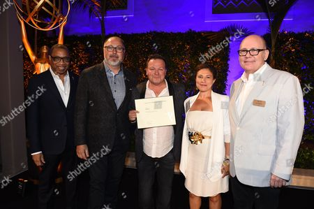 Stock Image of Tim Gibbons, Hayma Washington, Monica Beletsky, Chad Oakes, Mike Frisley. Monica Beletsky, Chad Oakes and Mike Frisley pose with Tim Gibbons and Hayma Washington at the 2017 Producers Nominee Reception presented by the Television Academy on in Beverly Hills, Calif