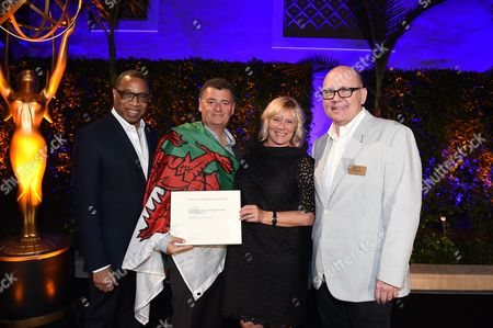 Stock Photo of Tim Gibbons, Hayma Washington, Steven Moffat, Sue Vertue. Steven Moffat and Sue Vertue pose with Tim Gibbons and Hayma Washington at the 2017 Producers Nominee Reception presented by the Television Academy on in Beverly Hills, Calif