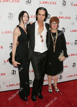 Stock Picture of Susie Bick, Nick Cave and Polly Borland attend the LA premiere of Lawless at Arclight Cinemas Hollywood, in Los Angeles