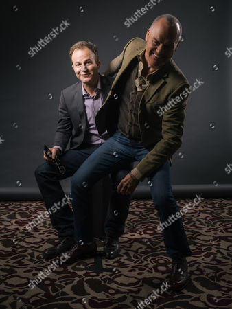 """Thomas McCarthy and Michael Keaton goof around during a portrait session for """"Spotlight"""" at The Four Seasons, in Los Angeles"""