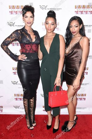 "Nicole Murphy, from left, Bria Murphy and Shayne Murphy attend ""SUBCONSCIOUS"" by Bria Murphy Gallery Opening at Lace Gallery, in Los Angeles"