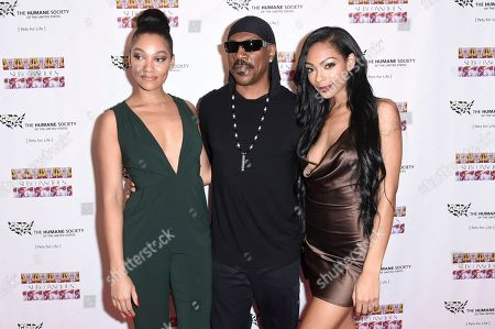"Bria Murphy, from left, Eddie Murphy and Shayne Murphy attend ""SUBCONSCIOUS"" by Bria Murphy Gallery Opening at Lace Gallery, in Los Angeles"