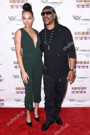 """Bria Murphy, left, and Eddie Murphy attend """"SUBCONSCIOUS"""" by Bria Murphy Gallery Opening at Lace Gallery, in Los Angeles"""