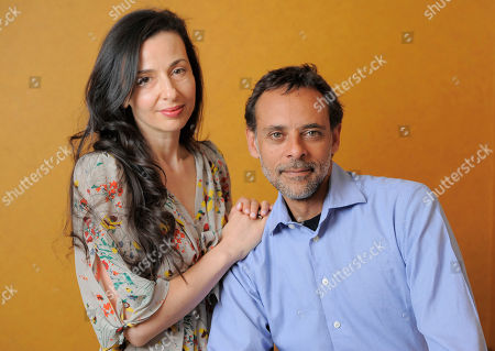 "Ruba Nadda, left, writer/director of the film ""Inescapable,"" poses with cast member Alexander Siddig for a portrait at the 2012 Toronto Film Festival, in Toronto"