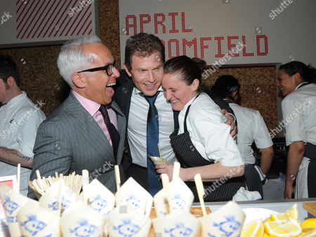 Chefs Bobby Flay, center, and Geoffrey Zakarian, left, share a laugh with Best New Chef alum April Bloomfield at the 2013 FOOD & WINE Best New Chefs 25th anniversary celebration at Pranna in New York