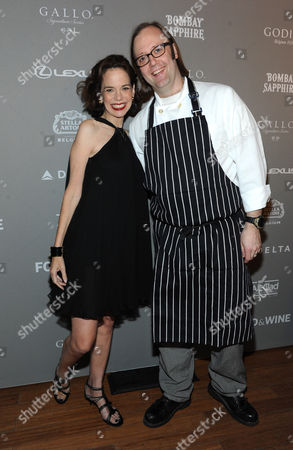 Stock Image of FOOD & WINE's editor in chief Dana Cowin, left, poses with Best New Chef alum Wylie Dufresne at the 2013 FOOD & WINE Best New Chefs 25th anniversary celebration at Pranna in New York