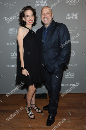 FOOD & WINE editor in Chief Dana Cowin, left, and Tom Colicchio, of Bravo's Top Chef, pose together at the 2013 FOOD & WINE Best New Chefs 25th anniversary celebration at Pranna in New York
