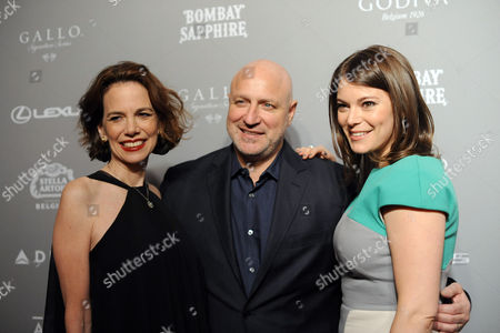 FOOD & WINE's editor in Chief Dana Cowin, left, and Gail Simmons, right, pose with Tom Colicchio, of Bravo's Top Chef, at the 2013 FOOD & WINE Best New Chefs 25th anniversary celebration at Pranna in New York