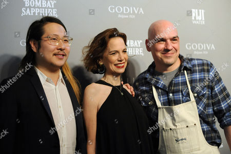 FOOD & WINE's editor in chief Dana Cowin, center, Best New Chef Danny Bowien, left, of Mission Chinese Food, and Best New Chef alum Michael Symon attend the 2013 FOOD & WINE Best New Chefs 25th anniversary celebration, at Pranna in New York