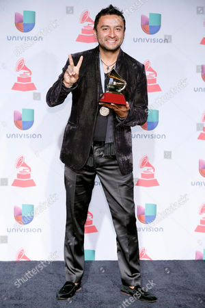 "Alex Campos poses with the award for best christina album (Spanish language) for ""Regreso a Ti"" backstage at the 14th Annual Latin Grammy Awards at the Mandalay Bay Hotel and Casino, in Las Vegas"