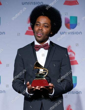 "Alex Cuba poses with the award for best short form music video for ""Eres Tu"" backstage at the 14th Annual Latin Grammy Awards at the Mandalay Bay Hotel and Casino, in Las Vegas"