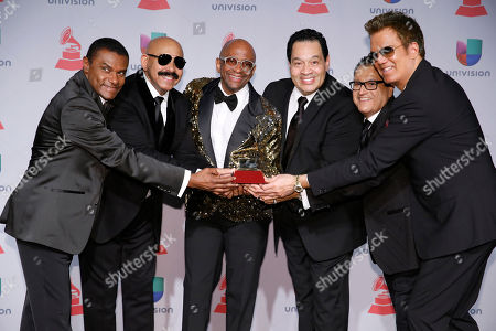 From left, Jose Alberto, El Canario, Oscar D' Leon, Sergio George, Tito Nieves, Ismael Miranda, and Willy Chirino pose backstage at the 14th Annual Latin Grammy Awards at the Mandalay Bay Hotel and Casino, in Las Vegas