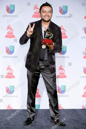 "Alex Campos poses with the award for best Christian album (Spanish language) for ""Regreso a Ti"" backstage at the 14th Annual Latin Grammy Awards at the Mandalay Bay Hotel and Casino, in Las Vegas"