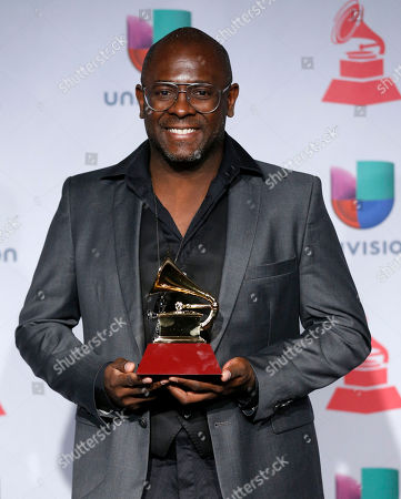 "Kleber Lucas poses with the award for best christian album (Portugese language) for ""Profeta Da Esperanca"" backstage at the 14th Annual Latin Grammy Awards at the Mandalay Bay Hotel and Casino, in Las Vegas"