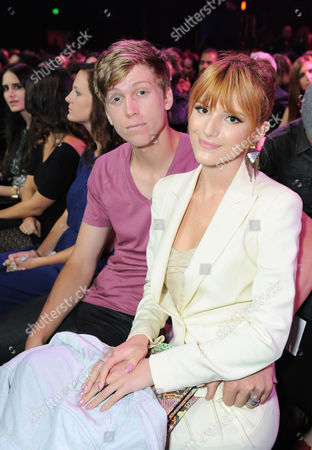 Actress Bella Thorne, right, and Tristan Klier attend the MTV Movie Awards in Sony Pictures Studio Lot in Culver City, Calif., on