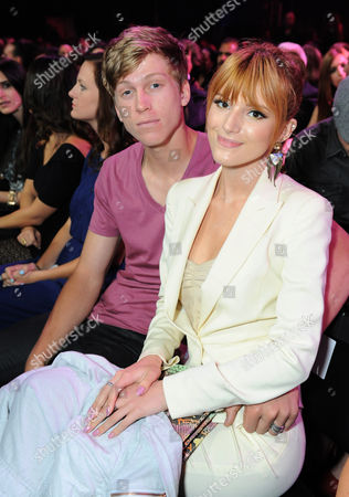 Tristan Klier, left, and Bella Thorne pose in the audience at the MTV Movie Awards in Sony Pictures Studio Lot in Culver City, Calif., on