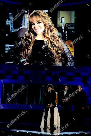 "The cast of ""Filly Brown"" present a tribute to Jenni Rivera, seen on screen, at the NCLR ALMA Awards at the Pasadena Civic Auditorium, in Pasadena, Calif"