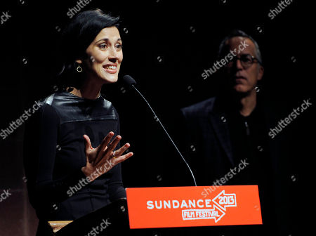 """Stock Picture of Cherien Dabis, writer, director and star of """"May in the Summer,"""" addresses the audience as John Cooper, director of the Sundance Festival, looks on at the premiere of the film on the opening night of the 2013 Sundance Film Festival, in Park City, Utah"""