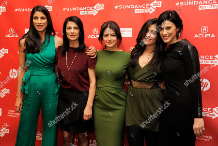 """Stock Image of Cherien Dabis, far right, writer, director and star of """"May in the Summer,"""" poses with cast members, from left, Ritu Singhe Pande, Hiam Abbass, Alia Shawkat and Nadine Malouf at the premiere of the film on the opening night of the 2013 Sundance Film Festival, in Park City, Utah"""
