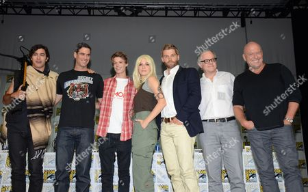 "Alexander Koch and from left, Eddie Cahill, Colin Ford, Rachelle Lefevre, Mike Vogel, Neal Baer and Dean Norris attend the ""Under the Dome"" panel on Day 1 of Comic-Con International, in San Diego"