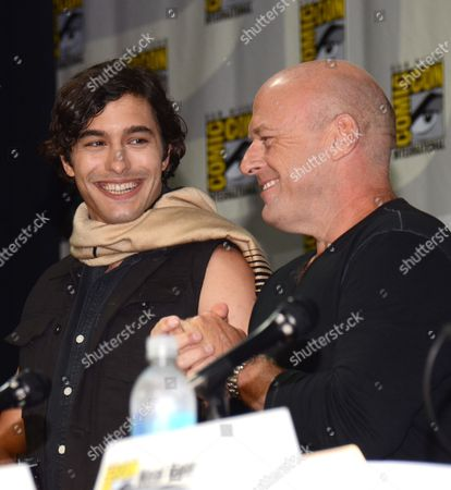 "Alexander Koch, left, and Dean Norris attend the ""Under the Dome"" panel on Day 1 of Comic-Con International, in San Diego"