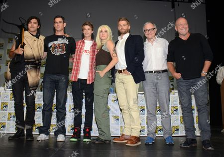 "Alexander Koch, from left, Eddie Cahill, Colin Ford, Rachelle Lefevre, Mike Vogel, Neal Baer and Dean Norris attend the ""Under the Dome"" panel on Day 1 of Comic-Con International, in San Diego"