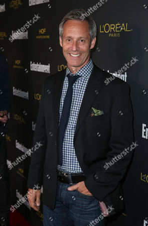 Michael Gill arrives at Entertainment Weekly's Pre-Emmy Party sponsored by L'Oreal Paris and Hearts On Fire at Fig & Olive in West Hollywood, Calif. on