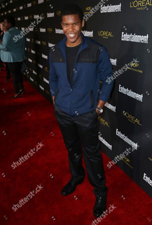 Gaius Charles arrives at Entertainment Weekly's Pre-Emmy Party sponsored by L'Oreal Paris and Hearts On Fire at Fig & Olive in West Hollywood, Calif. on