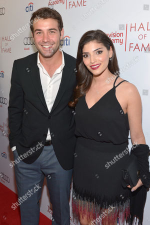 James Wolk, left, and Amanda Setton arrive at the 2014 Television Academy Hall of Fame, at the Beverly Wilshire in Beverly Hills, Calif