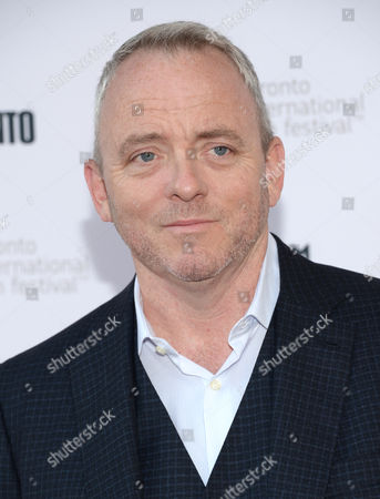 "Dennis Lehane arrives at the premiere of ""The Drop"" on day 2 of the Toronto International Film Festival at the Princess of Wales Theatre, in Toronto"
