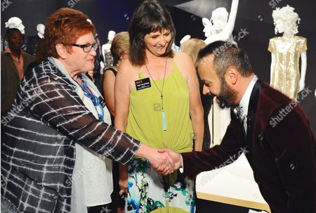The Television Academy's Sue Bub, from left, and Terry Ann Gordon seen with Nick Verreos at The 9th Annual Outstanding Art of Television Costume Design Exhibition opening at the FIDM Museum & Galleries on the Park, in Los Angeles. The Television Academy and FIDM Museum honored this year's Emmy(R) Award winners in Outstanding Costume Design at the opening reception for this annual special exhibition