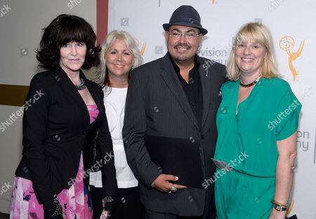 """Emmy nominees for the """"Mindy Project"""" Gala Autumn, left, and Salvador Perez, second right, Lisa Padovani of """"Gotham"""" second left, and Marie Schley of """"Transparent"""", right, seen at The 9th Annual Outstanding Art of Television Costume Design Exhibition opening at the FIDM Museum & Galleries on the Park, in Los Angeles. The Television Academy and FIDM Museum honored this year's Emmy(R) Award winners in Outstanding Costume Design at the opening reception for this annual special exhibition"""