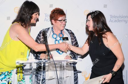 The Television Academy's Terry Ann Gordon, from left, and Sue Bub, present a plaque to Jenny Eagan for her Emmy nomination for Olive Kitteridge at The 9th Annual Outstanding Art of Television Costume Design Exhibition opening at the FIDM Museum & Galleries on the Park, in Los Angeles. The Television Academy and FIDM Museum honored this year's Emmy(R) Award winners in Outstanding Costume Design at the opening reception for this annual special exhibition