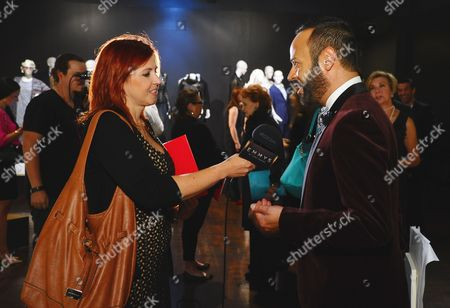 Nick Verreos, right, participates in an interview at The 9th Annual Outstanding Art of Television Costume Design Exhibition opening at the FIDM Museum & Galleries on the Park, in Los Angeles. The Television Academy and FIDM Museum honored this year's Emmy(R) Award winners in Outstanding Costume Design at the opening reception for this annual special exhibition