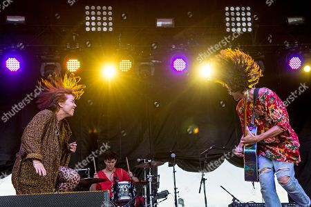 Hannah Hooper, from left, Ryan Rabin, and Christian Zucconi of Grouplove perform during day one of Forecastle Music Festival at Waterfront Park, in Louisville, Ky