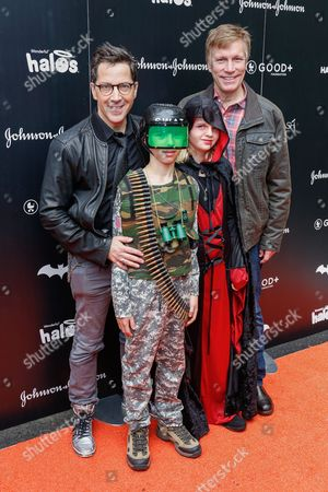 Stock Photo of Dan Bucatinsky, from left, Don Roos and family attend the 2016 GOOD + Foundation Halloween Bash at Gower Studios, in Los Angeles