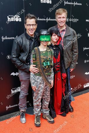 Dan Bucatinsky, from left, Don Roos and family attend the 2016 GOOD + Foundation Halloween Bash at Gower Studios, in Los Angeles