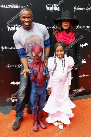 Sean Patrick Thomas, from left, Aonika Laurent and family attend the 2016 GOOD + Foundation Halloween Bash at Gower Studios, in Los Angeles