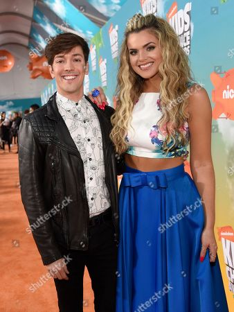 Roger Gonzalez, left, and Isabella Castillo arrives at the Kids' Choice Awards at The Forum, in Inglewood, Calif