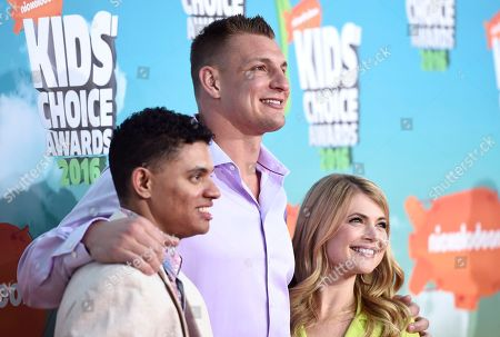 Brandon Broady, from left, NFL player Rob Gronkowski and Stevie Nelson arrive at the Kids' Choice Awards at The Forum, in Inglewood, Calif