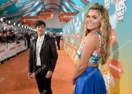Isabella Castillo arrives at the Kids' Choice Awards at The Forum, in Inglewood, Calif. Looking on at left is Roger Gonzalez