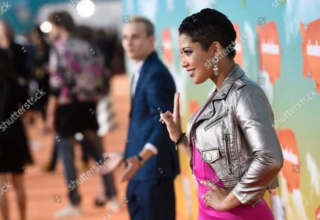 Patricia Kazadi arrives at the Kids' Choice Awards at The Forum, in Inglewood, Calif