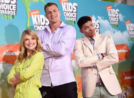 Stevie Nelson, from left, NFL player Rob Gronkowski and Brandon Broady arrive at the Kids' Choice Awards at The Forum, in Inglewood, Calif