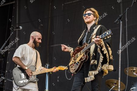 Sam Harris of X Ambassadors, left, performs with Jamie N Commons on day 3 of Lollapalooza, in Chicago