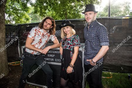 Justin Stahley, from left, Ritzy Bryan, and Rhydian Dafydd of The Joy Formidable pose on day 3 of Lollapalooza, in Chicago