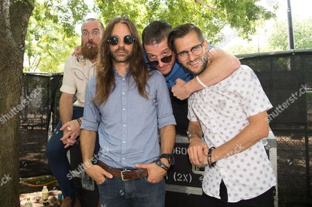 Darren King, from left, Todd Gummerman, Paul Meany, Roy Mitchell-Cardenas of Mutemath pose on day 3 of Lollapalooza, in Chicago