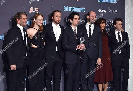 """Gary Gilbert, from left, Emma Stone, Ryan Gosling, Damien Chazelle, Jordan Horowitz, Mary Zophres, and Justin Hurwitz pose in the press room with the award for best picture for """"La La Land"""" at the 22nd annual Critics' Choice Awards at the Barker Hangar, in Santa Monica, Calif"""
