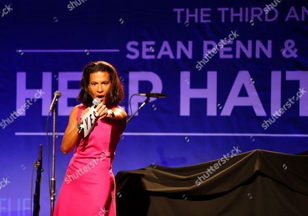 Andrea Fiuczynski is seen on stage during the auction at the 3rd Annual Sean Penn & Friends HELP HAITI HOME Gala on at the Montage Hotel in Beverly Hills, Calif