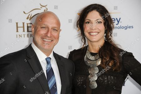 "Tom Colicchio, left, and Lori Silverbush arrives at the 3rd Annual Beyond Hunger ""A Place At The Table"" Gala, in Beverly Hills, Calif"